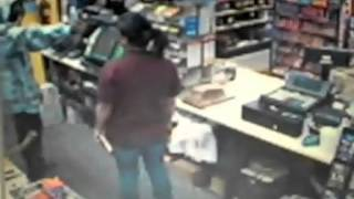 Woman Fights Back Shop Robber