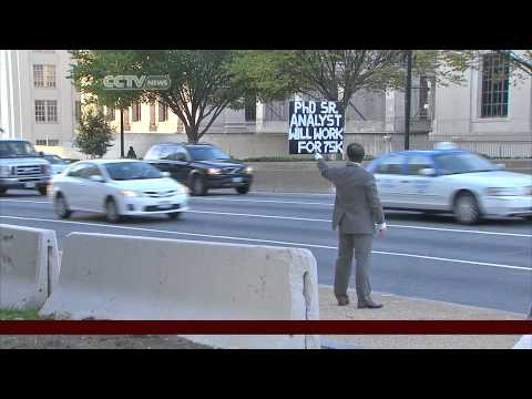 Unemployed PhD takes job hunt to busy DC streets