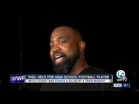 Vigil held for Deerfield Beach High School football star killed by train