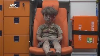 Child Rescued From Airstrike Rubble in Aleppo