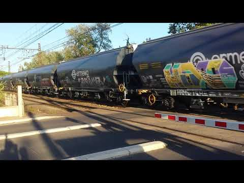French freight train with loco 66209 at railroad crossing in Agde France