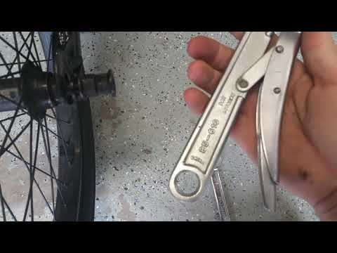 How to fix/ tighten a wobbly loose rear BMX bike wheel / hub