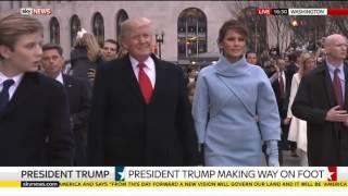 President Trump walks down Pennsylvania Avenue during inaugural parade protests 2017