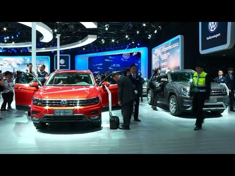 Global carmakers show off vehicles as China pledges reform