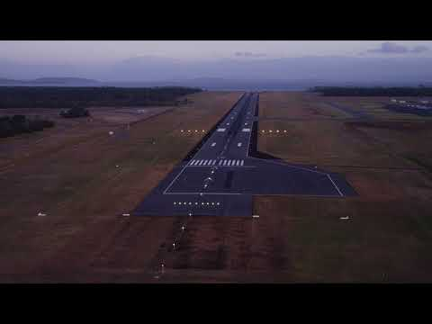 A drone flies over Hobart Airport's newly extended runway