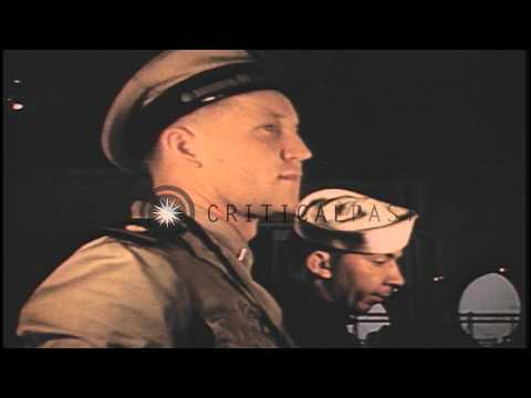 A US Coast Guards ensign in the wheelhouse of an LCI in Normandy, France during W...HD Stock Footage