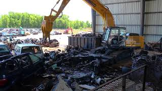 Video still for Kobelco SK210D-10 Dismantles Cars in Minutes