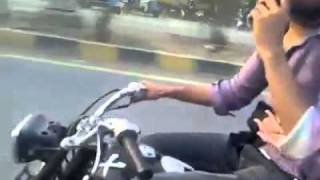 Repeat youtube video Lahore girl and boy on bike sexy wheeling