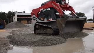 skid-steer-filling-pot-holes