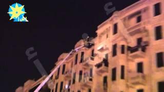 بالفيديو : عشرات من سيارات المطافي تسيطر على حريق فى احدى العمارات المطلة على ميدان التحرير