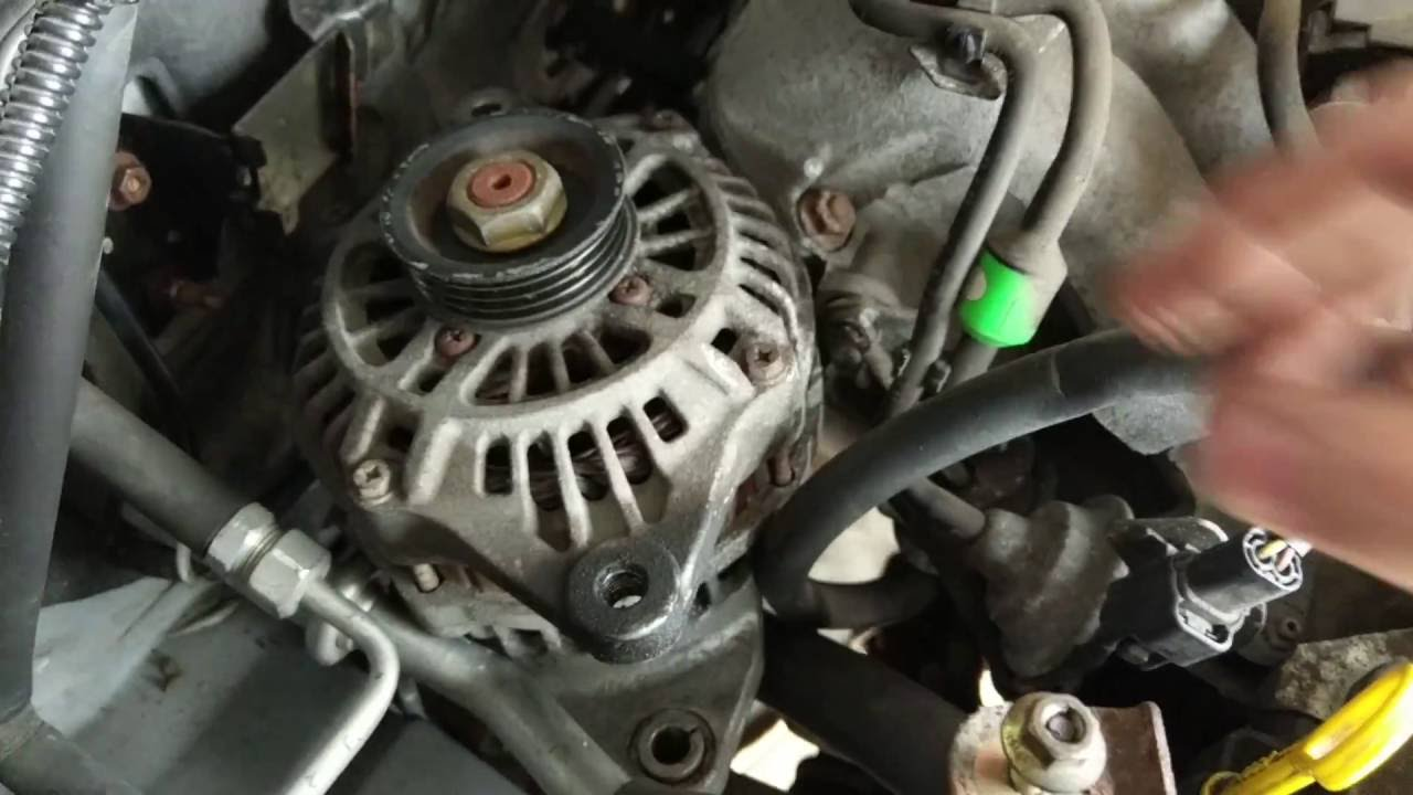 how to remove the alternator out of the engine bay 2001 2002 2003 mazda protege [ 1280 x 720 Pixel ]