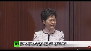 Carrie Lam heckled by protesters during policy address