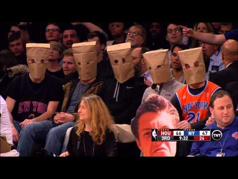 Knicks fans wearing paper bags during loss to Houston (1-8-15)