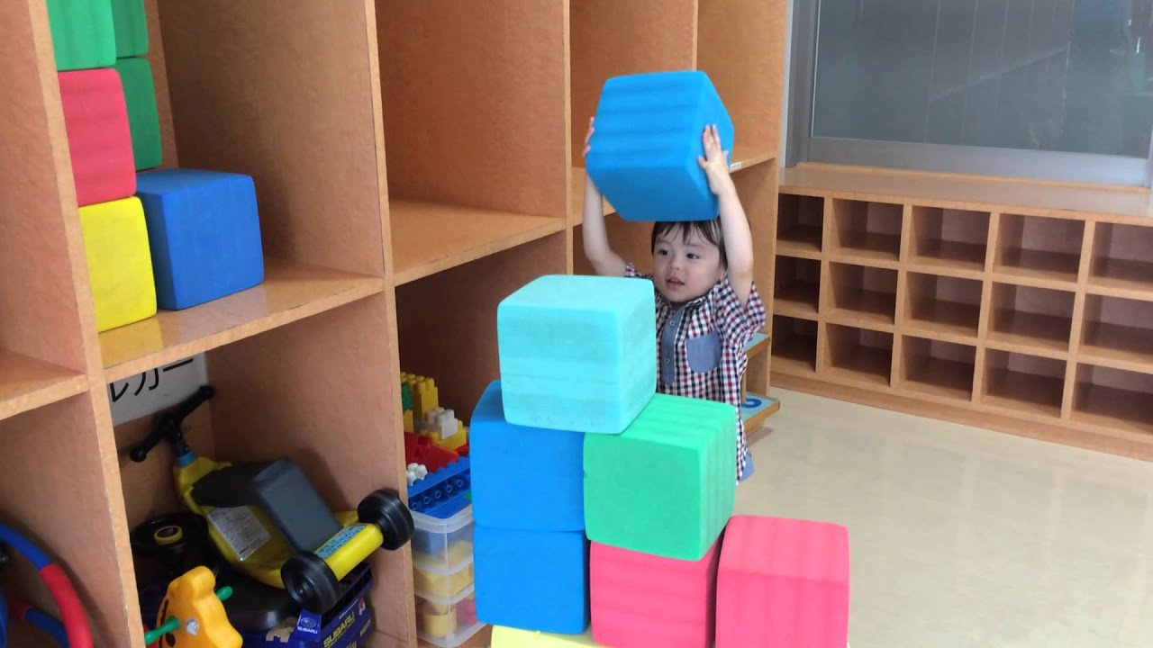 Kid Playing with Big Blocks Aden Building Something with Big