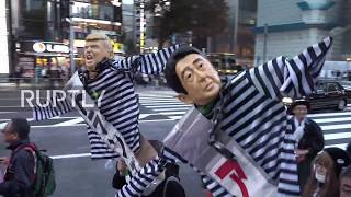 Japan: Protests in Tokyo as Trump golfs with Abe