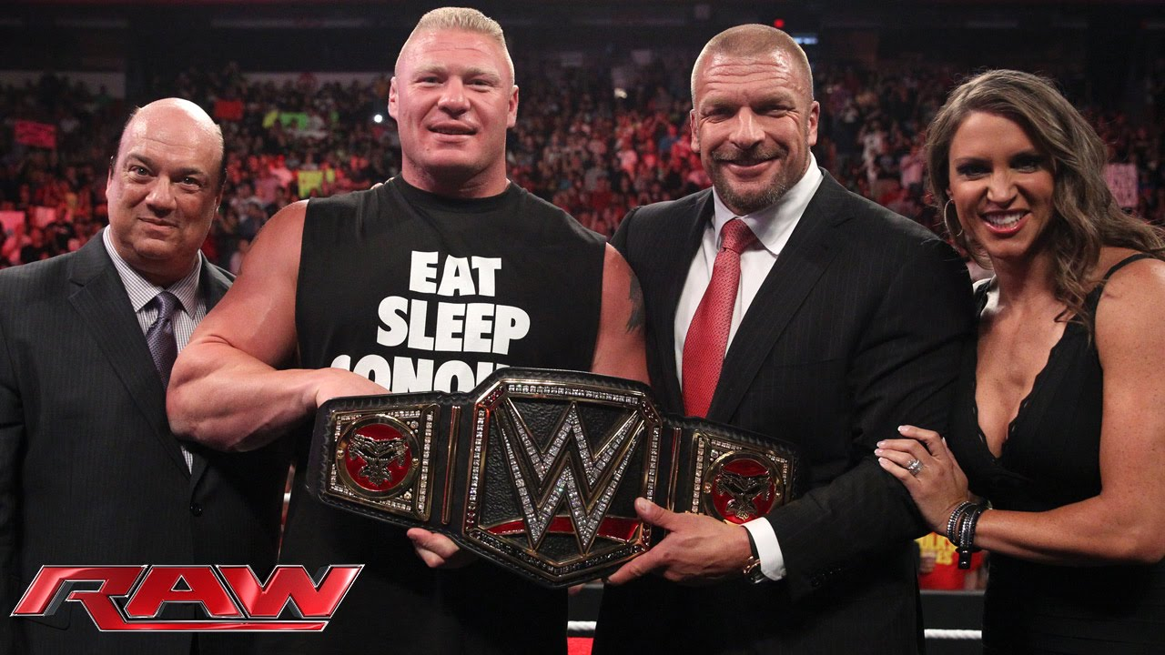 Brock Lesnar receives the new WWE World Heavyweight ...