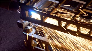 Grinding and smoothing of a metal in a factory - Fire sparks in process