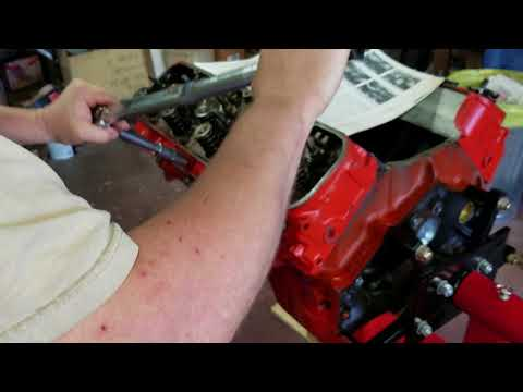 How to install a head on a big black chevy  Part 4