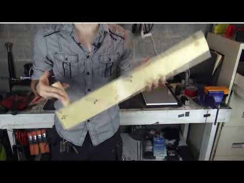 A Working AR-15 Bump Stock Made Out of a 2X4 Board