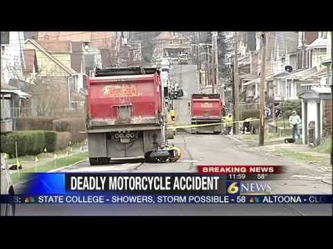 Man killed in motorcycle-dump truck crash in J