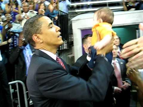Barack holding Afghan baby:)