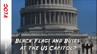 What are the black flags at the US Capitol and why are there so many buses around the Congress?