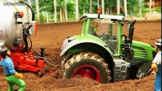 TRACTOR stuck in mud at work -modified Fendt  need help by 2 John Deere rc tractors