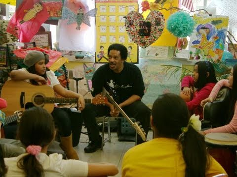 Jon E. Gee visits a Little Kids Rock school in the Manhattan, New York and delivers a bass guitar