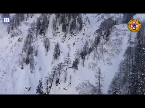 Rescue helicopter sweeps Italian Alps for avalanche victims