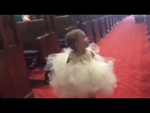Bride and groom's daughter as flower girl...when she sees her daddy!