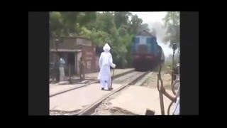 Daring or Foolish  Old man Faces Fast Train in India