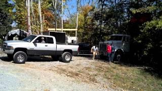 1999 dodge 2500 cummins pulling a dump truck