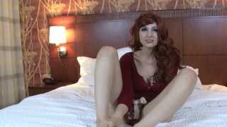 beautiful redhead girl shows her feet