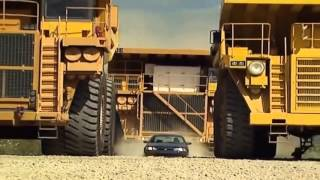 The Biggest Dump Truck in The World vs Sedan Car