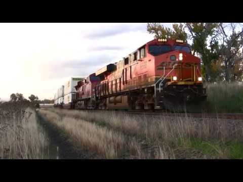 BNSF stack train accelerates past the ancient search light signal in Colorado