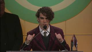 Cameron Boyce accepts the Pioneering Spirit award from the Thirst Project