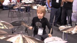 Kids playing drums at NAMM 2013.