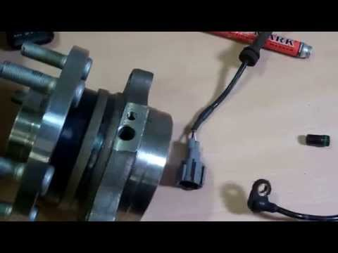 How to change the front ABS sensor on a Nissan Navara D40
