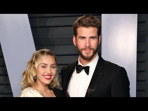 Miley Cyrus & Liam Hemsworth Make RARE Red Carpet Appearance At Oscars Party
