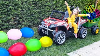 Öykü and Water filled colorful ballons new big jeep-fun kid video