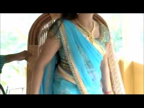 Navya Nair Hot Navel Show while in Interview