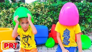 Os ovos enormes surpreendem o desafio dos brinquedos com corrediça inflável para Vlad