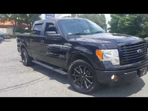 "2014 Ford F150 Rolling out of Rimtyme Of Charlotte sitting on 22"" Heavy Hitter (HH10s)"