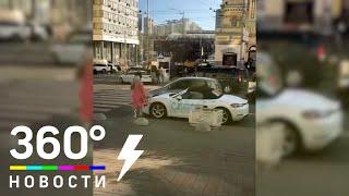 سيدة تحطم سيارة بورش بالفأس.. فيديو