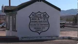 Historic Route 66 Sign on Building near Railroad Crossing at Kingman Arizona with Zoom out Views