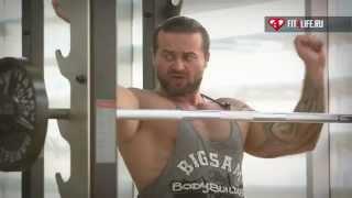 видео Жим штанги с груди стоя или сидя