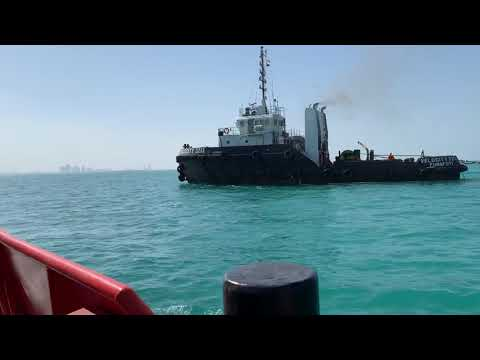 Towing tug Velocity 3213 and Barge Rapid 3211 berthing