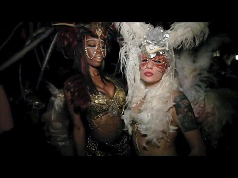 Mystical masquerade party with sexy girls and flashes of the Venetian carnival