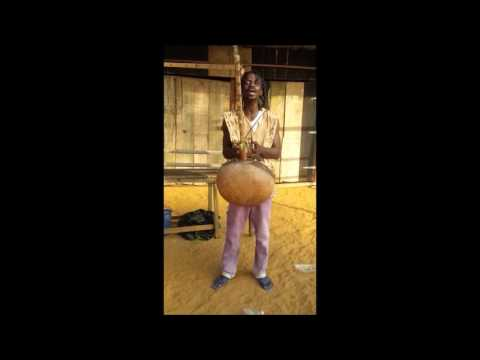 Griot singing with a Kora - Ivory Coast West Africa
