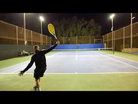 Playing with vintage tennis racquets